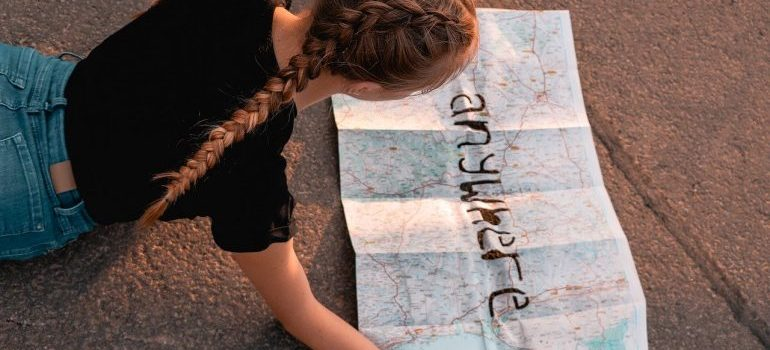 A girl looking at a map.