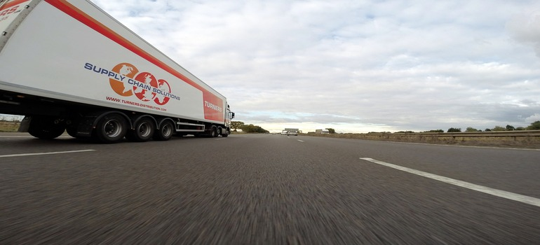 highway and a moving truck