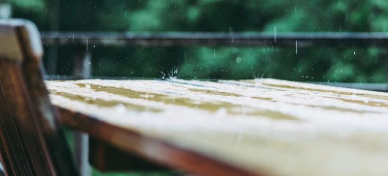 Rain pouring on an outdoor table
