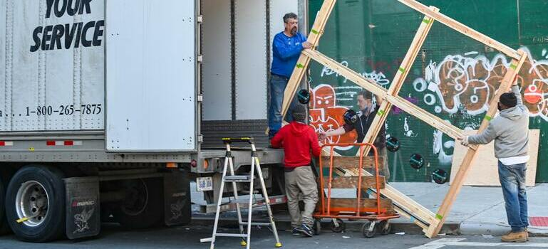 people loading the moving truck