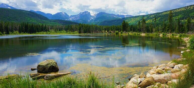 folks moving from California to Colorado and visiting a lake