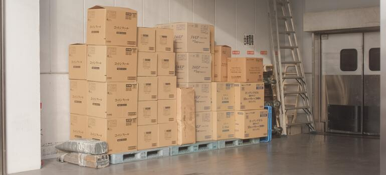 thinking how hiring movers can help you be more environmentally-friendly in CA when using boxes