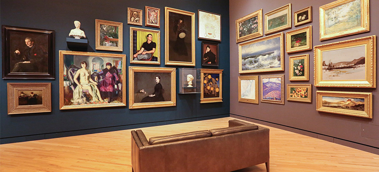 a room full of paintings