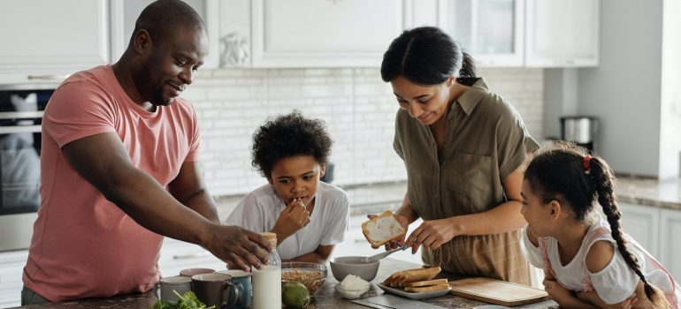 A family making breakfast together