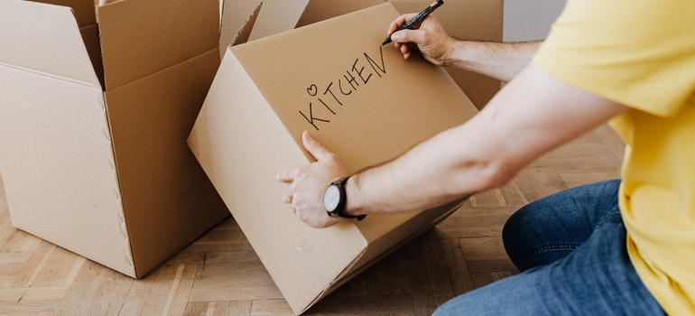 Man packing and moving bulky items