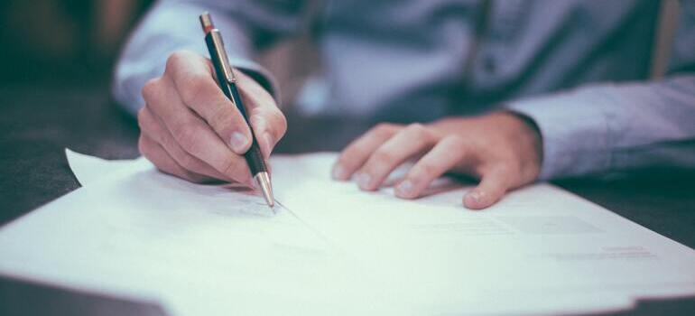 person signing the papers
