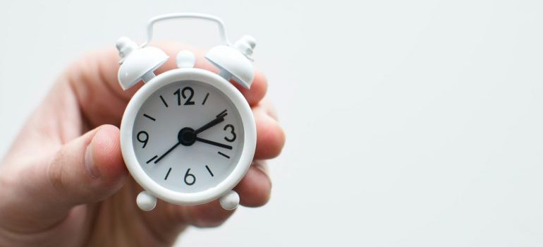 person holding a clock